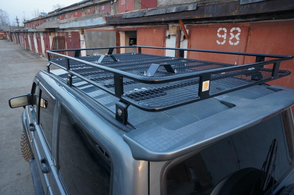 Крепеж багажника к водостокам